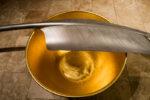 Detail: Goldene Schale, Feder